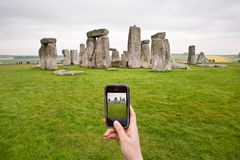 Taking photo for stonehenge with cell phone Stock Images