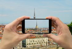 Taking photo in Torino. Tourist man taking photo in with smartphone in Torino Royalty Free Stock Photography