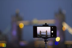Taking photo of Tower Bridge at evening Stock Photos
