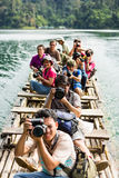 Taking photo while travel on bamboo raft Royalty Free Stock Photo