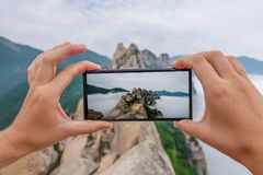 Taking Photo of Ulsanbawi Rock. Mountain in Seoraksan National Park, South Korea Royalty Free Stock Photo