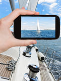 Taking photo of white sail yacht in Adriatic sea Royalty Free Stock Image
