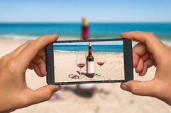 Taking photo of wine and glasses with mobile phone Royalty Free Stock Photo