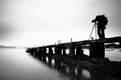 Taking photo on the wooden pier Stock Photography