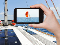 Taking photo yacht with red sail in Adriatic sea Stock Photography