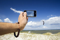 Taking photograph of kite surfer Stock Photography