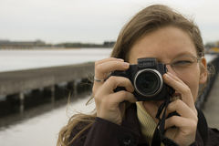 Taking photography. Portrait of Girl taking photography Royalty Free Stock Photography