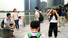 Taking Photography at Merlion statue and cityscape Stock Image