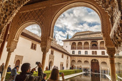 Taking photos at Alhambra. Taking photos of the pool inside Nasrid palace, one of the most photographed places at Alhambra. The Alhambra of Granada is considered stock photos
