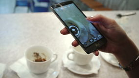 Taking photos of coffee on mobile phone  Stock Images