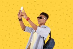 Happy person taking photos while traveling. Taking photos. Emotional positive person smiling and feeling happy while taking photos during his amazing trip royalty free stock photo