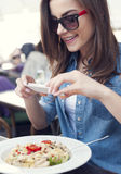 Taking photos of food Royalty Free Stock Images