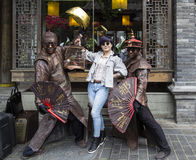 Taking photos with living sculpture in chengdu,china Royalty Free Stock Images