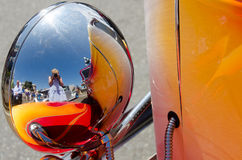 Taking photos at Northwest Deuce Days. Photographer is reflected in the chrome of the rear view mirror as she takes a photograph of a restored 1932 Ford Deuce Stock Image