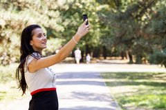 Taking photos in the park Royalty Free Stock Photos