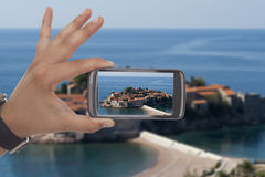 Taking a picture with black smartphone Stock Photography
