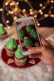 Taking Picture Of Christmas Dessert Royalty Free Stock Images