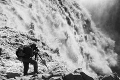Taking picture of Dettifoss waterfall Stock Images