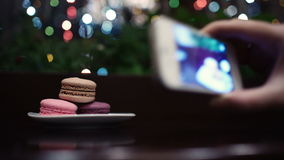 Taking a picture of macaroons. stock video footage