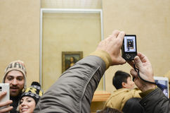 Taking picture of Mona Lisa. At Louvre, Paris, France Royalty Free Stock Photography