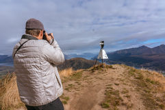 Taking picture near Lake Wakatipu and Queenstown Stock Image