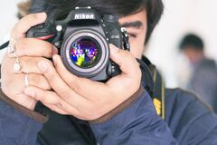 Taking a picture with a Nikon camera Royalty Free Stock Photo