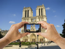 Taking a picture  of Notre Dame Royalty Free Stock Images