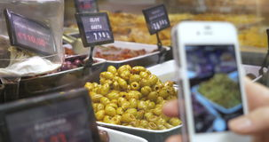 Taking picture of olives in the shop