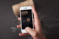 Taking picture with smartphone. On woodem background Stock Photography