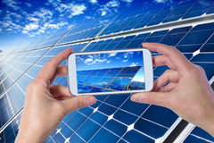 Taking picture of solar panels with smartphone Stock Images