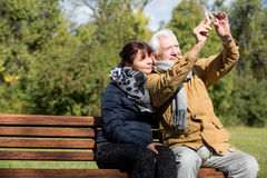 Taking picture of themselves. In the park Stock Photo