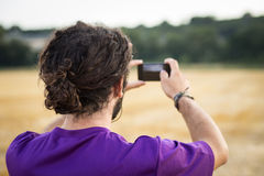 Taking a picture while trekking Royalty Free Stock Photography
