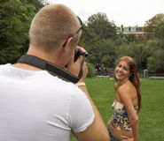 Taking pictures. Man taking pictures of his girlfriend Royalty Free Stock Photo