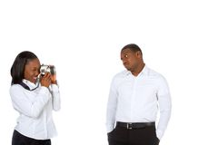Taking pictures. Young African-American female photographs her boyfriend Stock Photos