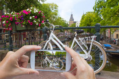 Taking pictures of a bicycle in Amsterdam (Netherlands) Royalty Free Stock Photo