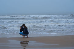 Taking Pictures. With cell phone in Matagorda, Texas Royalty Free Stock Photo