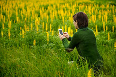 Taking pictures with a cellphone Stock Image