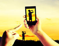 Taking pictures Children playing in sunset Royalty Free Stock Photo