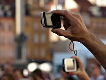 Taking pictures. Pictures of hand, photo taken smartphone, interesting photos, amateur photos royalty free stock image