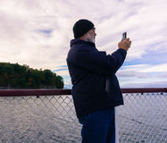Taking pictures on lake cruise Stock Images