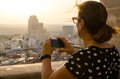 Taking pictures of Madrid skyline with mobile phone stock photo