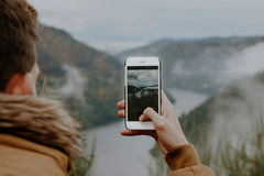 Taking pictures with the phone. To landscape Royalty Free Stock Photos