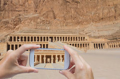 Taking pictures by smart phone in Hatsepsut Temple (Egypt) Royalty Free Stock Photos