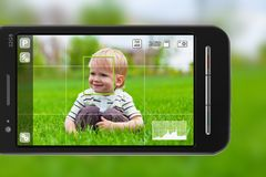 Taking pictures with smartphone. Taking pictures with mobile phone: smartphone in camera mode outdoors Stock Photography