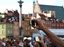 Taking pictures. Take pictures of hand, the picture in the crowd, amamtorskie photo, smartphone, filming, taking pictures, street life stock images