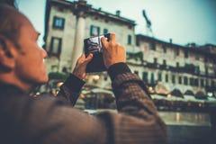 Taking Pictures of Verona. Caucasian Men Taking Pictures of Verona Using Smartphone Stock Images