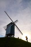 Taking pictures at a windmill in Bruges, Belgium Royalty Free Stock Images