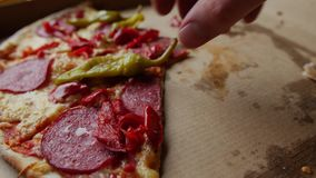 Taking pieces of pizza. stock video footage