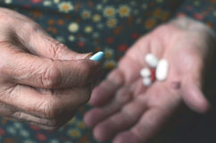Taking pill. A hand holding in order to take Royalty Free Stock Images