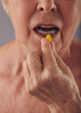 Taking a pill for good health Stock Photo